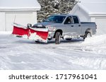 Silver Truck Moving Snow On A...