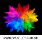 Small photo of colorful rainbow holi paint color powder explosion isolated on dark black background. peace rgb gaming beautiful party festival concept