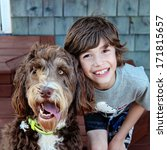 Stock photo young boy with pet dog closeup 171815657