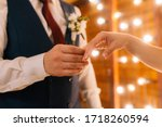 Wedding Rings In The Hands Of...