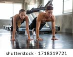 Young Fitness Couple Doing Push ...