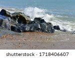 Large Rocks On A Stony Beach...