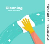 houseworker wipes the surface... | Shutterstock .eps vector #1718599267