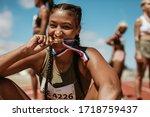 Excited Female Athlete Biting...