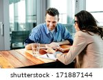 young couple at a table looking ... | Shutterstock . vector #171887144