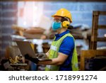 Small photo of Portrait man worker under inspection and checking production process on factory station by wearing safety mask to protect for pollution and virus in factory.