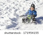 cute young boy sprayed with... | Shutterstock . vector #171954155