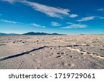 The Bonneville Salt Flats are a densely packed salt pan in Tooele County in northwestern Utah. The area is a remnant of the Pleistocene Lake Bonneville and is the largest of many salt flats located we