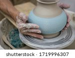Hands Of A Potter Working With...