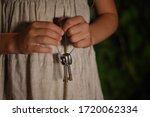 A Girl In A Linen Dress Holdin...