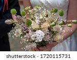Bride Holding Purple White And...