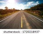 Empty Asphalt Road Through The...