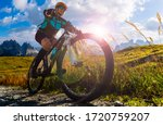 Small photo of Cycling outdoor adventure in Dolomites. Cycling woman in Dolomites landscape. Woman cycling MTB enduro trail track. Outdoor sport activity.