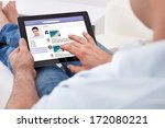 close up of man browsing on... | Shutterstock . vector #172080221