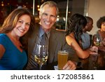 mature couple enjoying drink in ... | Shutterstock . vector #172085861