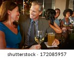 mature couple enjoying drink in ... | Shutterstock . vector #172085957