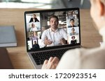 Small photo of Close up of woman worker talk brainstorm on video call on computer with diverse colleagues, have online team briefing together, female employee engaged in webcam conference on laptop with coworkers