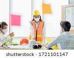 Group of creative building architect construction engineer project meeting and brainstorm together. Industry, Engineer, construction concept. Members wear face mask prevent covid-19 virus - stock photo