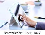 businesswoman holding digital... | Shutterstock . vector #172124027