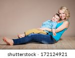 portrait of a young mother and... | Shutterstock . vector #172124921