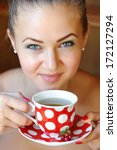 beautiful woman holds the cup... | Shutterstock . vector #172127294
