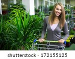 young girl in a flower shop | Shutterstock . vector #172155125