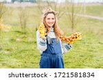 a smiling young farmer girl in...