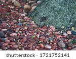 Pebbles At The Base Of A Large...
