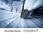 car tires on winter road | Shutterstock . vector #172259177
