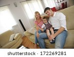 happy young family using tablet ... | Shutterstock . vector #172269281