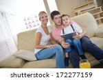 happy young family using tablet ...   Shutterstock . vector #172277159