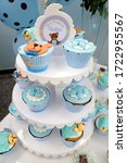 Small photo of Rio de Janeiro, Brazil - 12/10/2016: Teddy bear cupcake. Baby shower. It's a boy. Blue theme. Hector's welcome in portuguese language