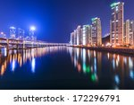 Busan, South Korea at Gwangan Bridge and Suyeong River.  - stock photo