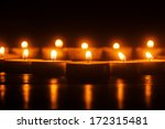 burning candles in a row - stock photo
