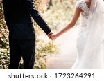 The hands of the bride and groom touch each other.Gentle touches, hugs. Wedding, celebration, ceremony