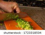 woman hand cutting raw green...