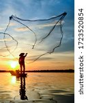 Small photo of Fisherman throwing out fishing net on the lake. Fisherman throwing net at sunrise