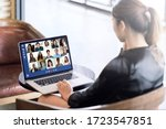 Small photo of Back view of young asian business woman work remotely at home video conference remote call to corporate group. Meeting online,videocall, group discuss online concept with screen of teamwork on laptop.