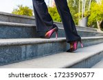 Business Woman Climbs The...