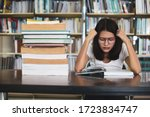 Young Student Girl Sitting At A ...