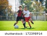 Boys  Kicking Football On The...