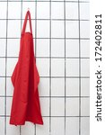 Small photo of Red apron hangs on wall.