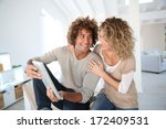 happy couple at home websurfing ... | Shutterstock . vector #172409531