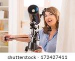 beautiful woman looking skyward ...   Shutterstock . vector #172427411