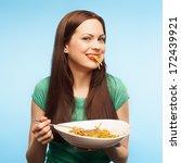 Girl Eats Pasta. Isolated