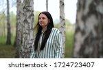 girl walks in a birch grove on...   Shutterstock . vector #1724723407