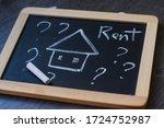 Word 'rent' Written On A Chalk...