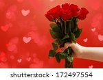 male hands holding roses  love... | Shutterstock . vector #172497554