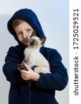 Little Boy With His Pet Siames...