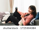 young woman at home using... | Shutterstock . vector #1725304384